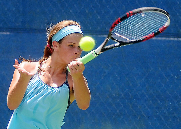 Grace Dillingham concentrates as she hits a return to Sarah Reilly at Oakwood Country Club Saturday, June 21, 2014. Reilly defeated Dillingham 6-4, 6-2 to win the match. (Staff Photo by BONNIE VCULEK)