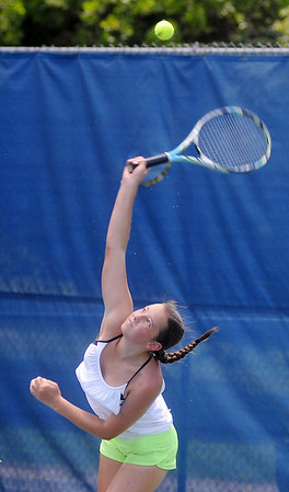 Sarah Reilly serves to Grace Dillingham at Oakwood Country Club Saturday, June 21, 2014. Reilly won the match 6-4, 6-2. (Staff Photo by BONNIE VCULEK)
