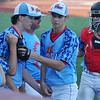 D-Bats' relief pitcher, Aaron Stramel (second from the right) receives congratulations after the Mustangs defeat the Texas Stix 18's 4-2 to win the Connie Mack Regional Qualifier Championship at David Allen Memorial Ballpark in Enid Sunday, June 21, 2015. (Staff Photo by BONNIE VCULEK)