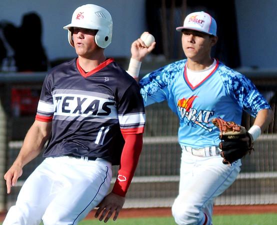 D-Bat Elite's Corey Roberts (14) runs down Texas Stix 18's Casey Johnson along the third base line as D-Bat's win the Connie Mack Regional Qualifier Championship at David Allen Memorial Ballpark Sunday, June 21, 2015. (Staff Photo by BONNIE VCULEK)