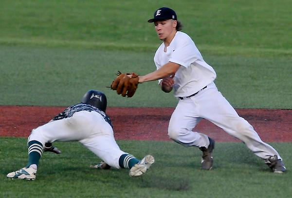 Enid Major's Kamen Lounsbury tags out Tyler Blaise of Batter's Box 17 at David Allen Ballpark. (Staff Photo by BILLY HEFTON)