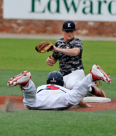 Enid Major's Blake Shepard tags out Parker Noren of the Frozen Ropes trying to steal second Wednesday at David Allen Ballpark during the Connie Mack Regional Qualifing Tournament. (Staff Photo by BILLY HEFTON)