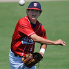 Woodward Traveler's Caden Calaway makes a throw to first Wednesday June 8, 2016 in the Oklahoma Shootout at David Allen Ballpark. (Billy Hefton / Enid News & Eagle)