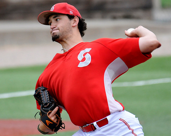 Sinclair's Eamon Catherina delivers a pitch against Mercer CC during an elimination game in the NJCAA DII World Series June 3, 2016 at David Allen Ballpark. (Billy Hefton / Enid News & Eagle)