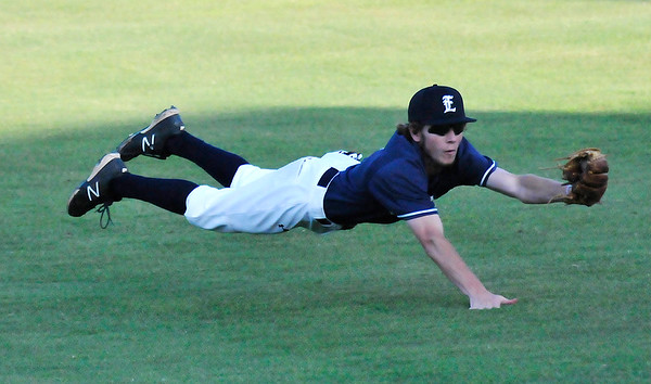 Enid Majors' Bryan Ramey makes a diving catch in right field against the Frozen Ropes Badarack Wednesday June 15, 2016 during the Connie Mack Regional Qualifing Tournament at David Allen Ballpark. (Billy Hefton / Enid News & Eagle)
