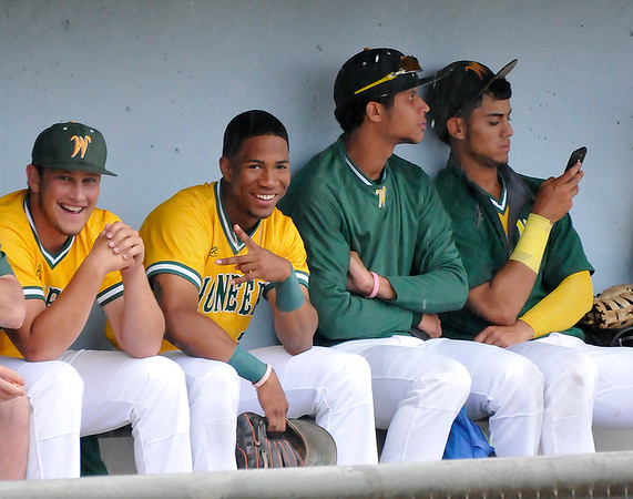 Western Oklahoma players wait out a rain delay Wednesday June 1, 2016 during the NJCAA DII World Series at David Allen Ballpark. (Billy Hefton / Enid News & Eagle)