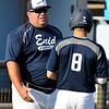 Enid Plainsmen coach, Brad Gore, coaches Connor Gore between innings Monday June 6, 2016 at David Allen Ballpark. (Billy Hefton / Enid News & Eagle)