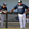 Enid Plainsmen coach, Brad Gore, visits with a player between innings Monday June 6, 2016 at David Allen Ballpark. (Billy Hefton / Enid News & Eagle)
