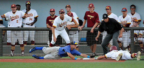 Gateway CC's Kyle Gibbs dives to tag out Jones County's Mason Irby at third base during the NJCAA DII World Series at David Allen Ballpark June 3, 3016. (Billy Hefton / Enid News & Eagle)