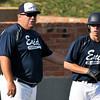 Enid Plainsmen coach, Brad Gore, talks to baserunner Colby Jarigan Monday June 6, 2016 at David Allen Ballpark. (Billy Hefton / Enid News & Eagle)
