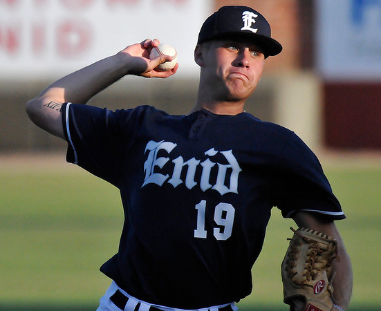 Enid Majors' Jonny Chavez delivers a pitch against the Frozen Ropes Badarack Wednesday June 15, 2016 during the Connie Mack Regional Qualifing Tournament at David Allen Ballpark. (Billy Hefton / Enid News & Eagle)