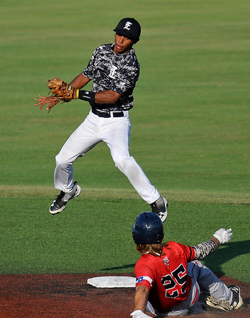 Enid Majors' Bryan Pacheco comes down to tag out a Texas Stix Red baserunner Thursday June 16, 2016 during the Connie Mack Regional Qualifing Tournament at David Allen Ballpark. (Billy Hefton / Enid News & Eagle)