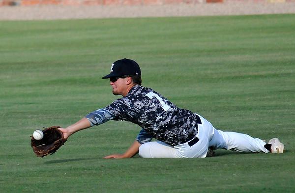 Enid Majors' Coleman Rhoads makes a sliding catch against the Enid Plainsmen Tuesday June 14, 2016 at David Allen Ballpark. (Billy Hefton / Enid News & Eagle)
