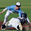 Enid Plainsmen's Ambren Voitik tags out Enid Majors' Luke Ball trying to steal second Tuesday June 14, 2016 at David Allen Ballpark. (Billy Hefton / Enid News & Eagle)