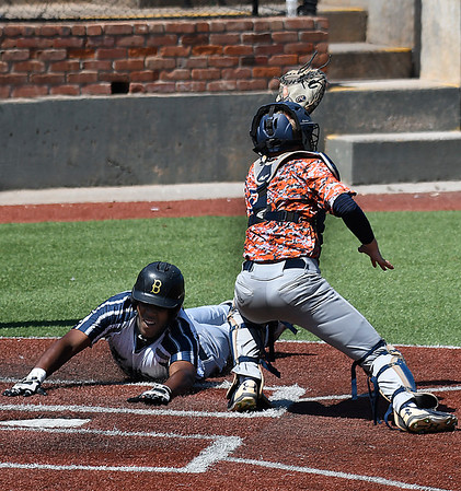 Enid Majors' E.J. Taylor dives around Ft. Smith Sportsmen catcher, Jake Smith, to score Saturday June 24, 2017 at David Allen Memorial Ballpark. (Billy Hefton / Enid News & Eagle)