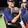 Kankakee CC's Kyle Flessner hugs the national championship trophy after defeating Mercer CC to win the 2017 NJCAA DII World Series Friday June 2, 2017 at David Allen Memorial Ballpark. (Billy Hefton / Enid News & Eagle)