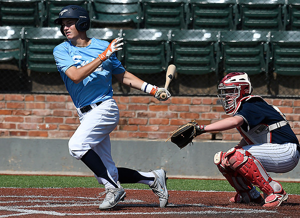 Enid Plainsmen, Connor Gore, gets a base hit against the Colorado Khaos Navy during the Connie Mack Regional Qualifing Tournament at David Allen Memorial Ballpark Thursday June 15, 2017. (Billy Hefton / Enid News & Eagle)
