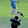 Enid Plainsmen, Brennan Vickers, leaps over Shane Mitchell of the Colorado Khaos Navy as he reaches for a high throw during the Connie Mack Regional Qualifing Tournament at David Allen Memorial Ballpark Thursday June 15, 2017. (Billy Hefton / Enid News & Eagle)