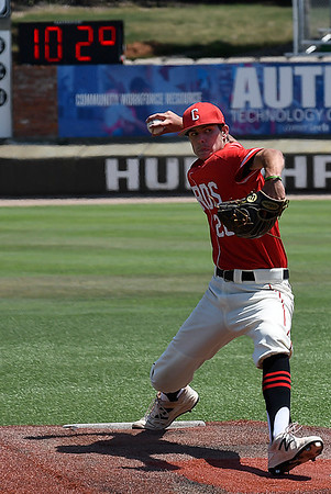 Cole Carey of the Catalyst Cardinals delivers a pitch during the Connie Mack Regional Qualifing Tournament as the temperature reads 102 degrees Friday June 16, 2017 at David Allen Memorial Ballpark. (Billy Hefton / Enid News & Eagle)