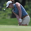 Kaylee Petersen chips onto the 18th green during the PGA South Central Sectional Tournament at Meadowlake Golf Course Wednesday June 14, 2017. (Billy Hefton / Enid News & Eagle)
