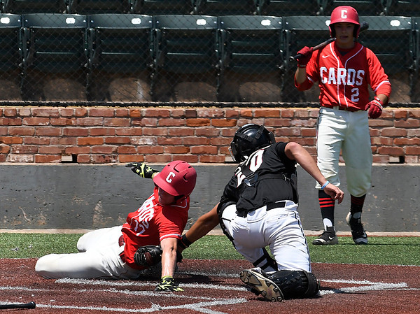 Tuttle's Riley Cross tags out Matt Kneesskern of the Catalyst Cardinals during the Connie Mack Regional Qualifing Tournament Friday June 16, 2017 at David Allen Memorial Ballpark. (Billy Hefton / Enid News & Eagle)