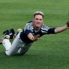 Enid Majors' (#28 not listed in program) makes a diving catch against Ft. Smith Kerwins Friday June 23, 2017 at David Allen Memorial Ballpark. (Billy Hefton / Enid News & Eagle)
