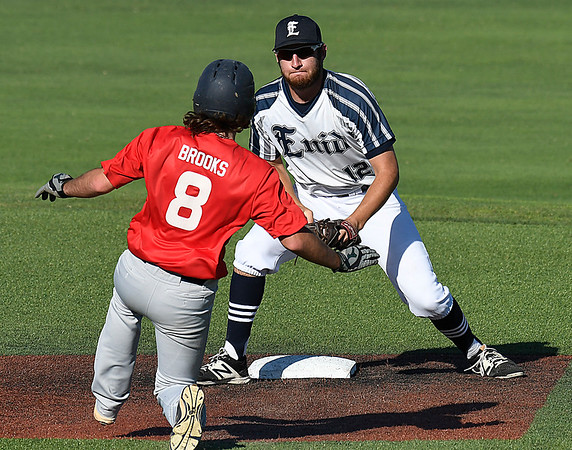 Enid Majors' Matt Conerly positions himself to tag Jacob Brooks of the OKC Expos Wednesday June 21, 2017 at David Allen Memorial Ballpark. (Billy Hefton / Enid News & Eagle)