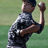 Enid Majors' Angel Gonzales delivers a pitch against Batters Box Gray at NOC's Failing Field Saturday June 17, 2017 during the Connie Mack Regional Qualifing Tournament. (Billy Hefton / Enid News & Eagle)