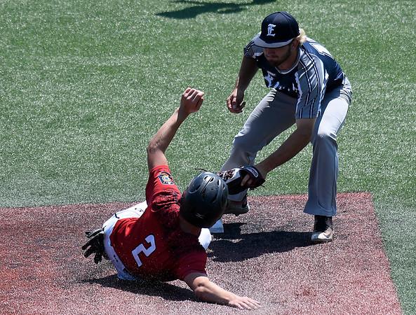 Enid Majors' Seth Graves tags out Colton Davis of Newton, Kansas June 29, 2017 at David Allen Memorial Ballpark. (Billy Hefton / Enid News & Eagle)