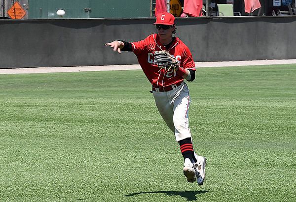 Judah Wilbur of the Catalyst Cardinals makes a throw to first during the Connie Mack Regional Qualifing Tournament Friday June 16, 2017 at David Allen Memorial Ballpark. (Billy Hefton / Enid News & Eagle)