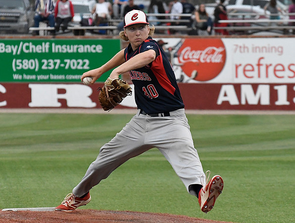 Kankakee CC's Colton Carr delivers a pitch against Mercer CC in the 2017 NJCAA DII World Series Friday June 2, 2017 at David Allen Memorial Ballpark. (Billy Hefton / Enid News & Eagle)