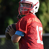 Chisholm's Braden Meek looks for a receiver during a 7 on 7 camp Thursday June 21, 2018 at Chisholm High School. (Billy Hefton / Enid News & Eagle)