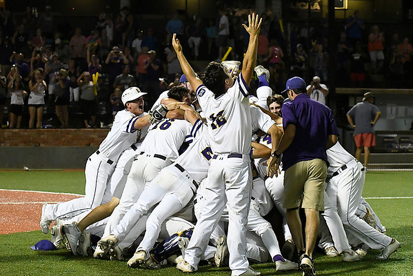 LSU Eunice's Justin Barton raises his arms as team mates dog pile following their 5-3 victory over Parkland CC to win the 2018 NJCAA DII World Series Friday June 1, 2018 at David Allen Memorial Ballpark. (Billy Hefton / Enid News & Eagle)
