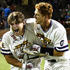 LSU Eunice's Slate Fuller (left) lets out a yell while getting hugged by Hayden Mixon after his walk off 2 run home run to give the Bengals a 5-3 victory over Parkland CC to win the 2018 NJCAA DII World Series Friday June 1, 2018 at David Allen Memorial Ballpark. (Billy Hefton / Enid News & Eagle)