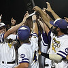 LSU Eunice players raise the national championship trophy following their 5-3 victory over Parkland CC in the 2018 NJCAA DII World Series Friday June 1, 2018 at David Allen Memorial Ballpark. (Billy Hefton / Enid News & Eagle)