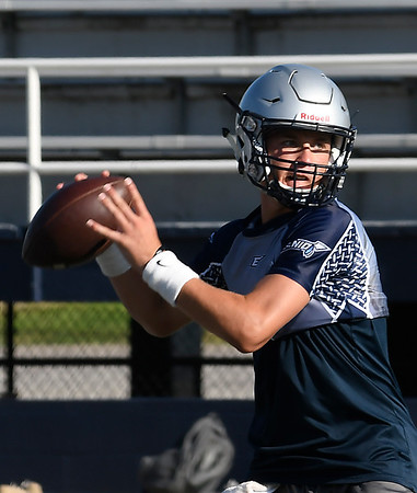 Enid's Blake Priest looks to throw a pass during a 7 on 7 practice with Woodward Monday June 25, 2018 at D. Bruce Selby Stadium. (Billy Hefton / Enid News & Eagle)