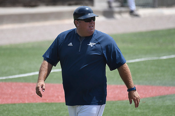 Enid Plainsmen coach, Brad Gore, walks back to the dugout during the Connie Mack Regional Qualifing Tournament Saturday June 16, 2018 at David Allen Memorial Ballpark. (Billy Hefton / Enid News & Eagle)