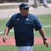 Enid Plainsmen coach, Brad Gore, walks back to the dugout during the Connie Mack Regional Qualifing Tournament Saturday June 16, 2018 at David Allen Memorial Ballpark. (Billy Hefton / Enid News & Eagle)