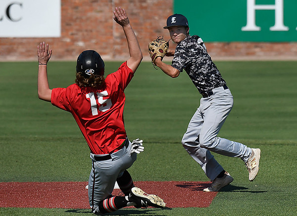 Enid Majors' Maddux Mayberry throws over Mustang's Dawson Kinney to complete a doubleplay Wednesday June 27, 2018 at David Allen Memorial Ballpark. (Billy Hefton / Enid News & Eagle)