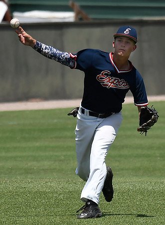 Austin Wood of the Oklahoma Expos makes a throw to first against the SW Shockers Black during the Connie Mack Regional Qualifing Tournament Friday June 15, 2018 at David Allen Memorial Ballpark. (Billy Hefton / Enid News & Eagle)