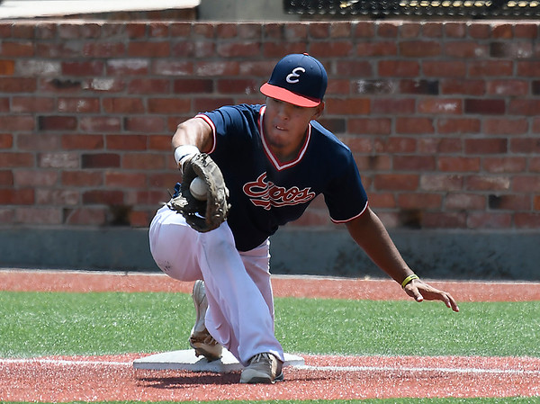 Kevin Porras of the Oklahoma Expos reaches for a throw against the SW Shockers Black during the Connie Mack Regional Qualifing Tournament Friday June 15, 2018 at David Allen Memorial Ballpark. (Billy Hefton / Enid News & Eagle)