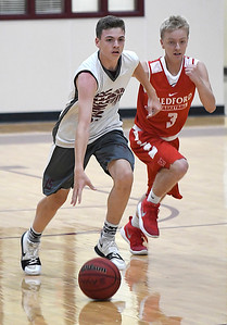 Pioneer's Kolby Vestal dribble upcourt against Medford during a game at the Pioneer Basketball camp Monday June 11, 2018. (Billy Hefton / Enid News & Eagle)
