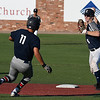 Enid Major's Ambren Voitik throws over Noah Yearout of Bartlesville for a doubleplay Friday June 22, 2018 at David Allen Memorial Ballpark. (Billy Hefton / Enid News & Eagle)