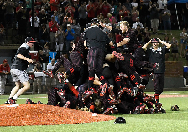 Members of the NOC Enid baseball team celebrate the Jets' 5-4 victory over Mesa CC to win the NJCAA DII national championship Friday, May 31, 2019, at David Allen Memorial Ballpark. (Billy Hefton / Enid News & Eagle)