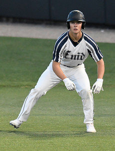 Enid Majors' Gage Ninness takes a lead off first base against Sandlot Painter Friday, June 14, 2019, during the Connie Mack Regional qualifying tournament at David Allen Memorial Ballpark. (Billy Hefton / Enid News & Eagle)