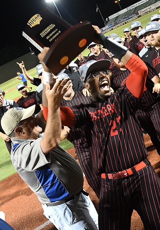 NOC Enid's E.J. Taylor rasies the national championship trophy following the Jets' 5-4 victory over Mesa CC to win the NJCAA DII national championship Friday, May 31, 2019, at David Allen Memorial Ballpark. (Billy Hefton / Enid News & Eagle)