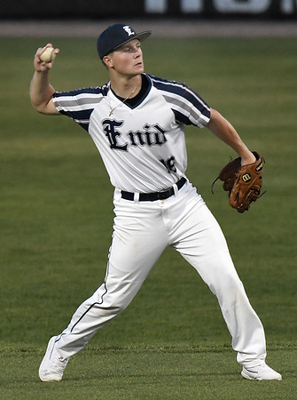Enid Majors' Gage Ninness throws athe ball to first between innings against Sandlot Painter Friday, June 14, 2019, during the Connie Mack Regional qualifying tournament at David Allen Memorial Ballpark. (Billy Hefton / Enid News & Eagle)