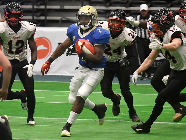 Flying Aces' Corey Avery gets loose for yardage against Sioux City Saturday, June 15, 2019, at the Stride Bank Center. (Billy Hefton / Enid News & Eagle)