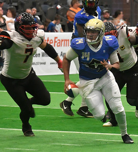 Flying Aces' RayJohn Ramsey scrambles out of the pocket against Sioux City Saturday, June 15, 2019, at the Stride Bank Center. (Billy Hefton / Enid News & Eagle)