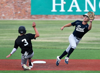 Enid Plainsmen's Maddux Mayberry field a wide throw as Oklahoma Mudcats' Kole Seeley steals second Wednesday, June 3, 2020 at David Allen Memorial Ballpark. (Billy Hefton / Enid News & Eagle)